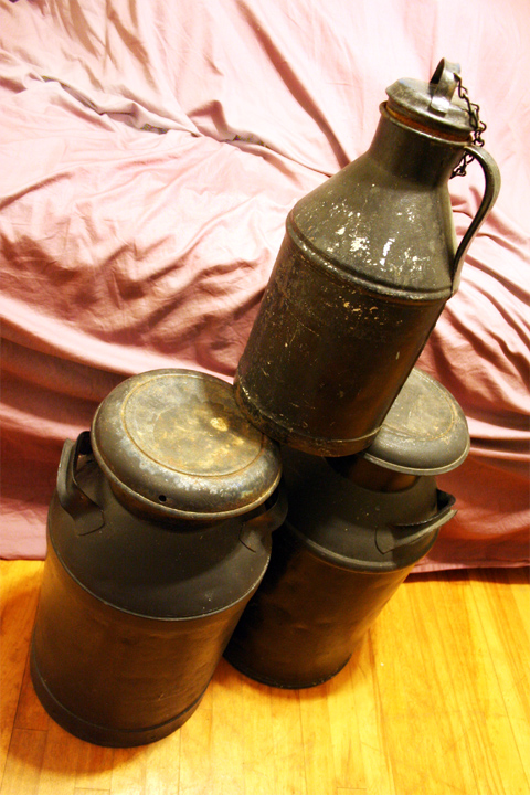set of milk cans
